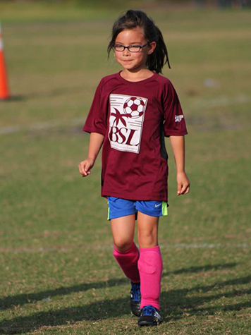 Girl Smiling Playing Youth Soccer