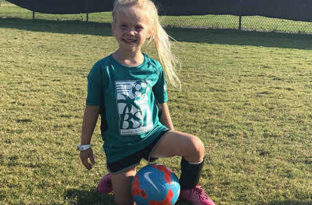 Young Girl Soccer Player Posing for a Picture